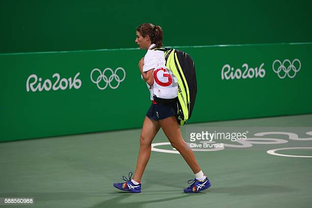 Johanna Konta of Great Britain leaves the court after defeat with Jamie Murray of Great Britain in the mixed doubles first round match against...