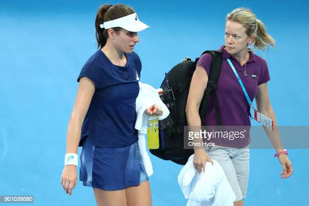 Johanna Konta of Great Britain leaves the court for treatment in her match against Elina Svitolina of Ukraine during day five of the 2018 Brisbane...