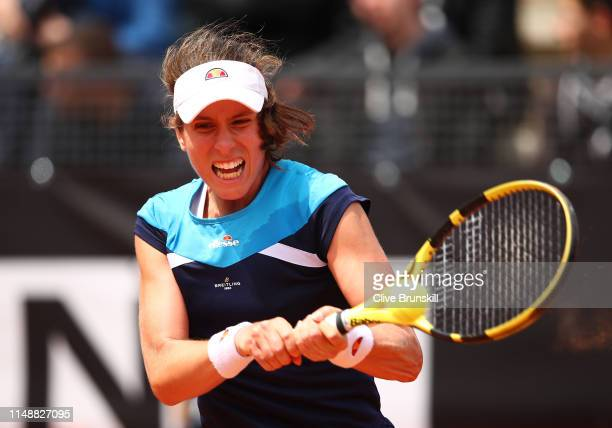 Johanna Konta of Great Britain plays a backhand against Alison Riske of the United States in their first round match during day two of the...