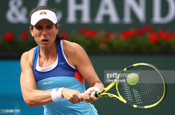 Johanna Konta of Great Britain plays a backhand against Kiki Bertens of the Netherlands during their women's singles third round match on day seven...