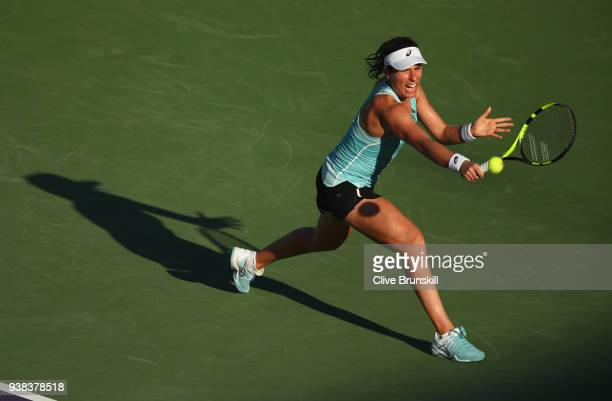 Johanna Konta of Great Britain plays a backhand against Venus Williams of the United States in their fourth round match during the Miami Open...