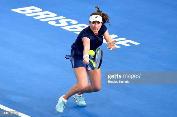 Johanna Konta of Great Britain plays a backhand in her match against Madison Keys of USA during day two of the 2018 Brisbane International at Pat...