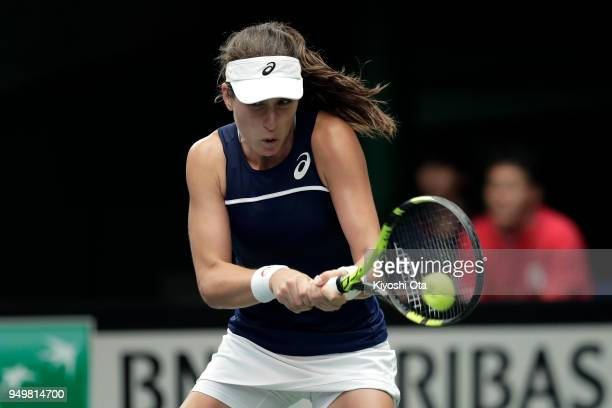 Johanna Konta of Great Britain plays a backhand in her singles match against Naomi Osaka of Japan during day two of the Fed Cup World Group II...