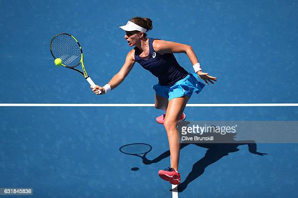 Johanna Konta of Great Britain plays a forehand in her first round match against Kirsten Flipkens of Belgium on day two of the 2017 Australian Open...