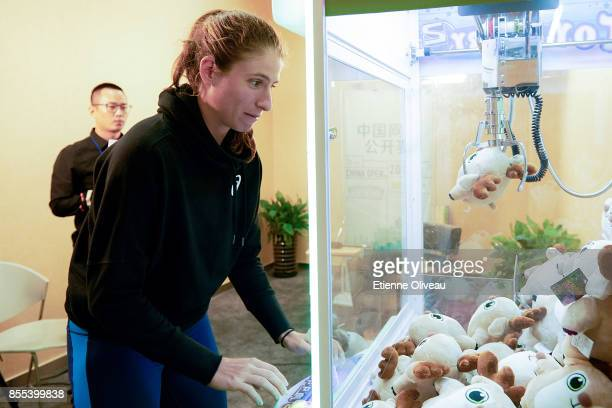 Johanna Konta of Great Britain plays a game after an interview during the preview day of the 2017 China Open at the China National Tennis Centre on...