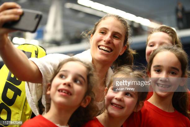 Johanna Konta of Great Britain pose for a photo with young fans following her victory in the round robin match against Dalila Jakupovic of Slovenia...