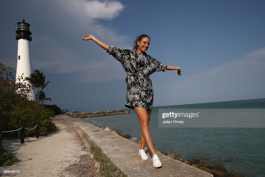 Johanna Konta of Great Britain poses next to a lighthouse during a photo shoot after she defeated Caroline Wozniacki of Denmark in the final at Cape Florida on April 1, 2017 in Key Biscayne, Florida.