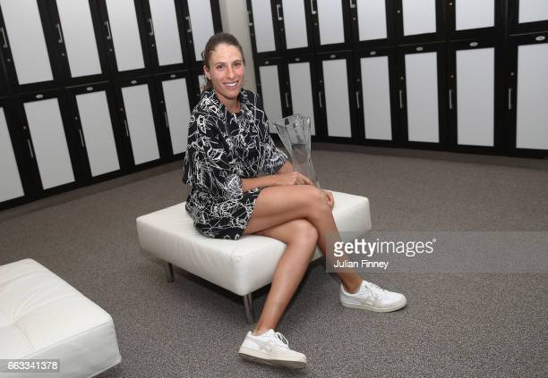 Johanna Konta of Great Britain poses with the trophy in the changing room after defeating Caroline Wozniacki of Denmark in the final at Crandon Park...