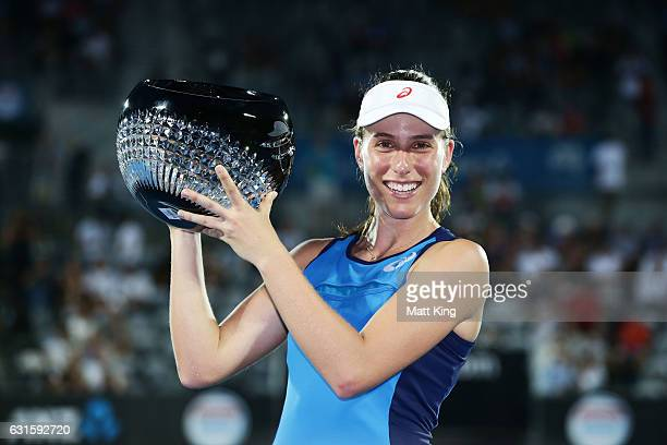 Johanna Konta of Great Britain poses with the winners trophy after the Womens Final match against Agnieszka Radwanska of Poland during the Sydney...