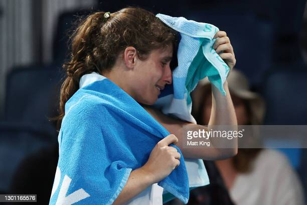 Johanna Konta of Great Britain reacts as she leaves the court after retiring with an injury in her Women's Singles first round match against Kaja...