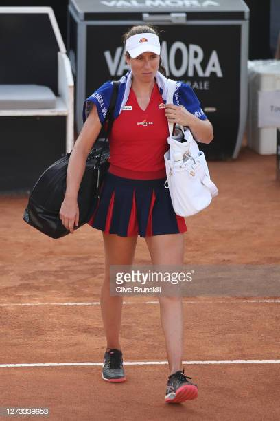 Johanna Konta of Great Britain reacts as she walks off the court after defeat in her round three match against Garbine Muguruza of Spain during day...