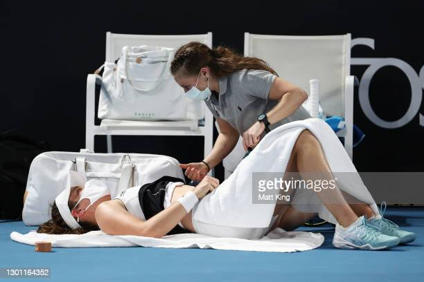 Johanna Konta of Great Britain receives medical treatment in her Women's Singles first round match against Kaja Juvan of Slovenia during day two of...