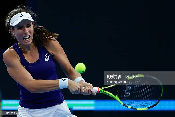 Johanna Konta of Great Britain returns a shot against Agnieszka Radwanska of Poland during Women's Singles final on day nine of the 2016 China Open...