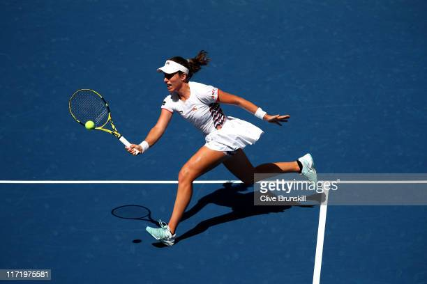 Johanna Konta of Great Britain returns a shot during her Women's Singles quarterfinal match against Elina Svitolina of the of the Ukraine on day nine...