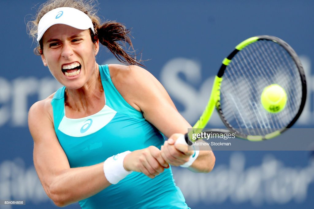 Johanna Konta of Great Britain returns a shot to Dominika Cibulkova of Slovakia during day 6 of the Western & Southern Open at the Lindner Family Tennis Center on August 17, 2017 in Mason, Ohio.