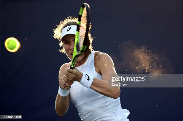 Johanna Konta of Great Britain returns a shot to Serena Williams of the United States during Day 2 of the Mubadala Silicon Valley Classic at Spartan...