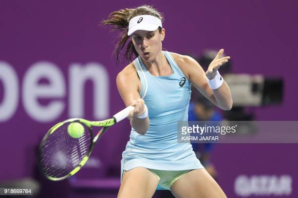 Johanna Konta of Great Britain returns the ball to Angelique Kerber of Germany as they compete in their singles match during the third round of the...