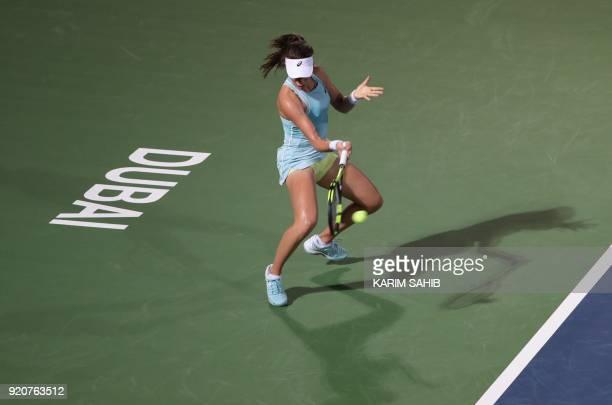 Johanna Konta of Great Britain returns the ball to Russia's Anastasia Pavlyuchenkova during day one of the WTA Dubai Duty Free Tennis Championship at...