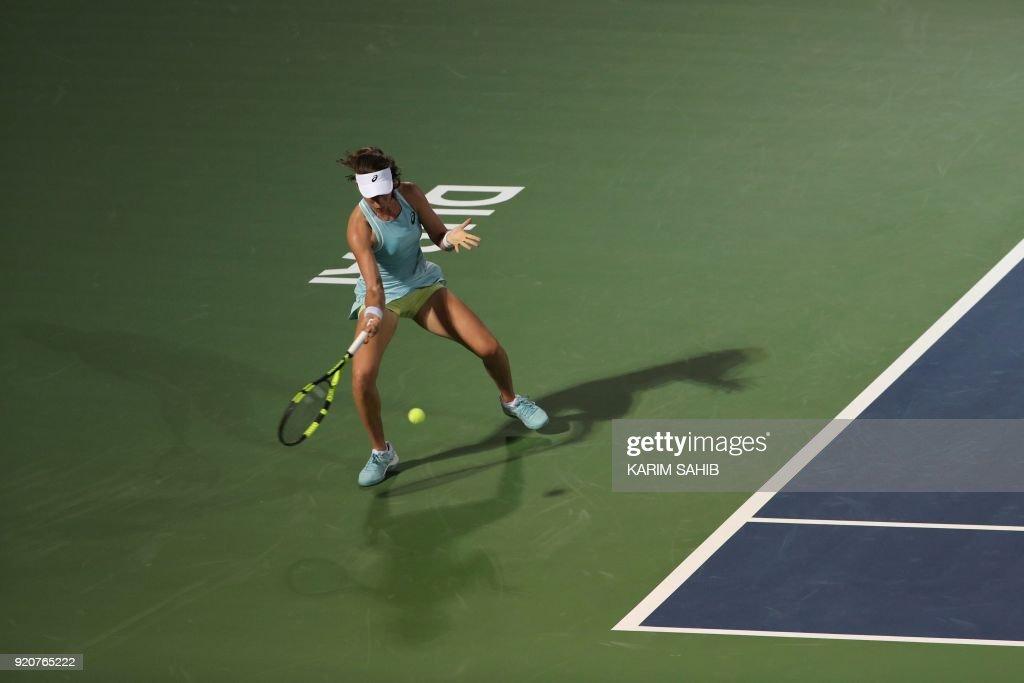 Johanna Konta of Great Britain returns the ball to Russia's Anastasia Pavlyuchenkova during day one of the WTA Dubai Duty Free Tennis Championship at the Dubai Tennis Stadium on February 19, 2018. /