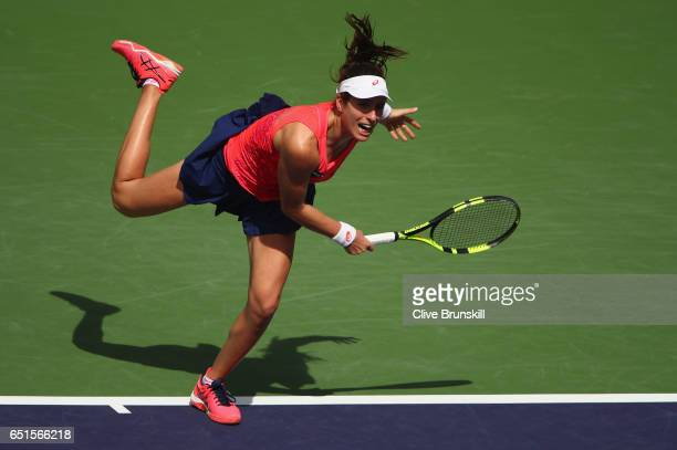 Johanna Konta of Great Britain serves against Heather Watson of Great Britain in their second round match during day five of the BNP Paribas Open at...
