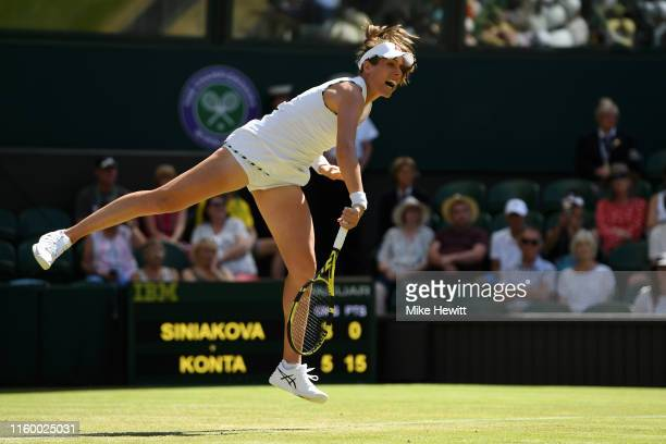 Johanna Konta of Great Britain serves against Katerina Siniakova of The Czech Republic during Day four of The Championships - Wimbledon 2019 at All...