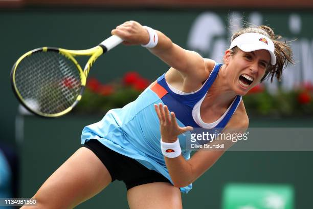 Johanna Konta of Great Britain serves against Kiki Bertens of the Netherlands during their women's singles third round match on day seven of the BNP...