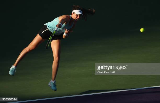 Johanna Konta of Great Britain serves against Venus Williams of the United States in their fourth round match during the Miami Open Presented by Itau...
