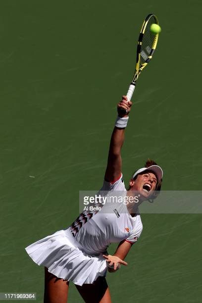 Johanna Konta of Great Britain serves during her Women's Singles quarterfinal match against Elina Svitolina of the of the Ukraine on day nine of the...