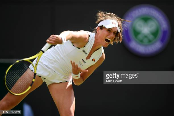 Johanna Konta of Great Britain serves in her Ladies' Singles first round match against Ana Bogdan of Romania during Day two of The Championships...