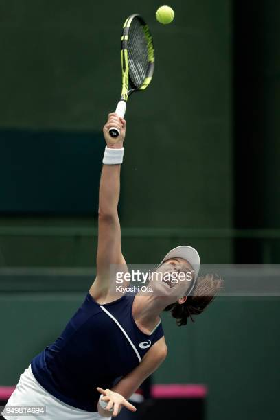 Johanna Konta of Great Britain serves in her singles match against Naomi Osaka of Japan during day two of the Fed Cup World Group II PlayOff between...