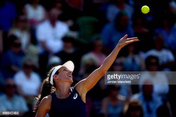 Johanna Konta of Great Britain serves partnering Yanina Wickmayer of Germany during their Women's Doubles semifinal match against Monique Adamczak...