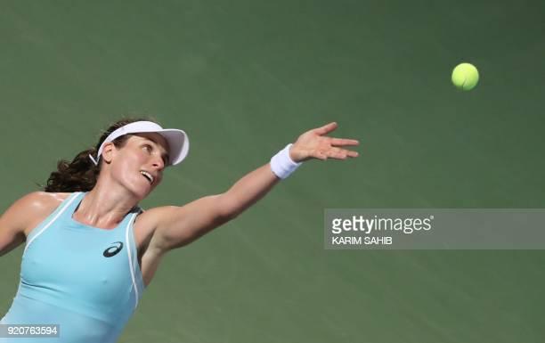 Johanna Konta of Great Britain serves the ball to Russia's Anastasia Pavlyuchenkova during day one of the WTA Dubai Duty Free Tennis Championship at...