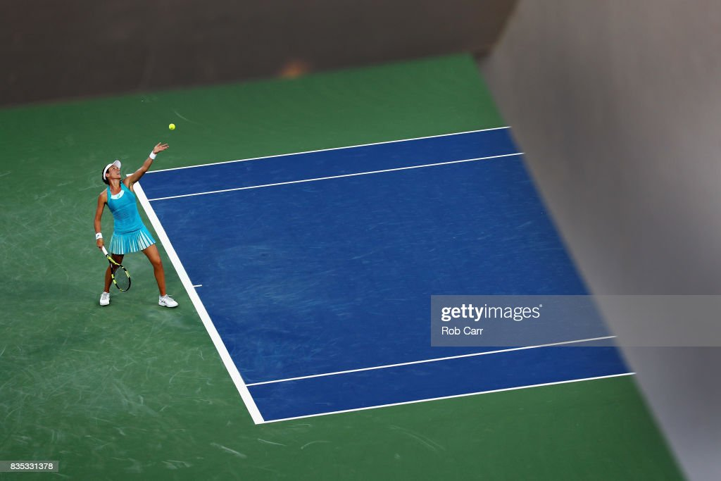 Johanna Konta of Great Britain serves to Simona Halep of Romania during Day 7 of the Western and Southern Open at the Linder Family Tennis Center on August 18, 2017 in Mason, Ohio.