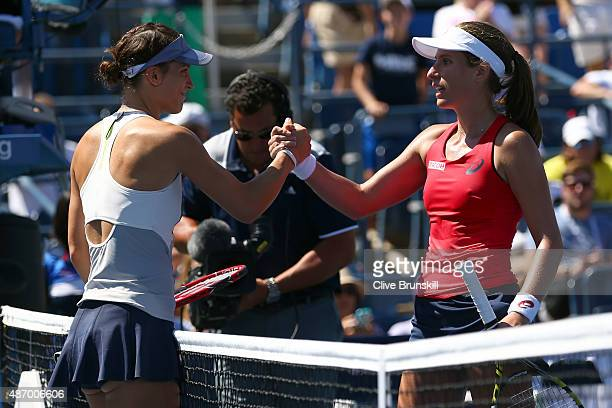 Johanna Konta of Great Britain shakes hands with Andrea Petkovic of Germany after their Women's Singles Third Round match on Day Six of the 2015 US...