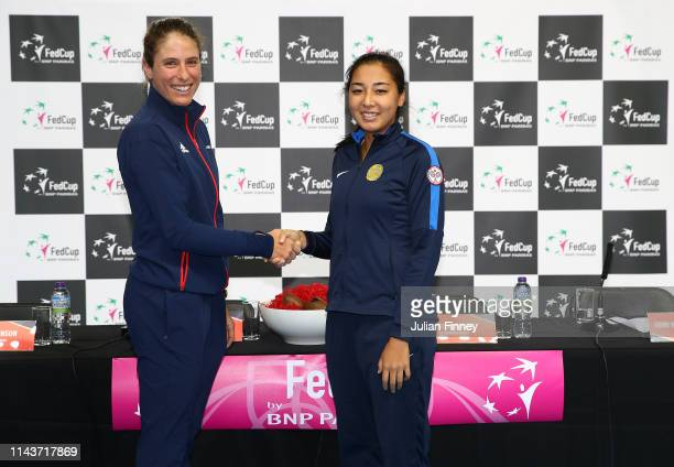 Johanna Konta of Great Britain shakes hands with her first opponent Zarina Diyas of Kazakhstan prior to the Fed Cup World Group II Play-Off match...