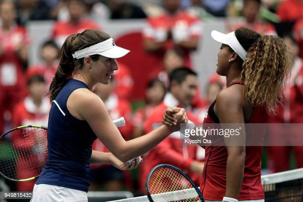Johanna Konta of Great Britain shakes hands with Naomi Osaka of Japan after their singles match during day two of the Fed Cup World Group II PlayOff...
