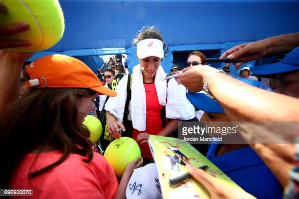 Johanna Konta of Great Britain signs autographs for fans after victory in her Women's Singles semifinal match against Magdalena Rybarikova of...