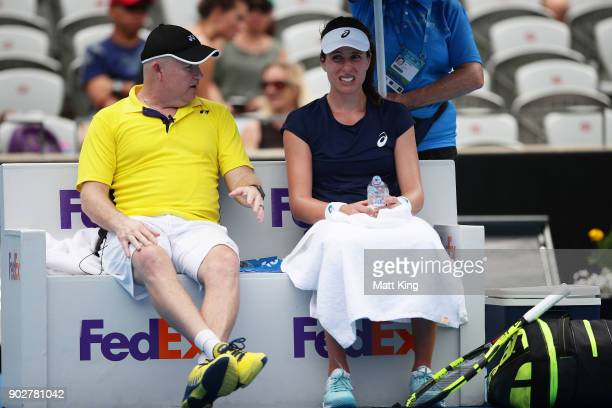 Johanna Konta of Great Britain speaks to her coach in her 1st round match against Agnieszka Radwanska of Poland during day three of the 2018 Sydney...