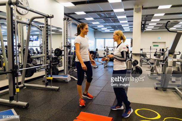 Johanna Konta of Great Britain speaks to her coach in the gym during the Great Britain Training session ahead of the Davis Cup by BNP Paribas...