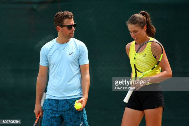Johanna Konta of Great Britain speaks to her coach Wim Fissette during a training session on day four of the Wimbledon Lawn Tennis Championships at...