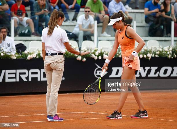 Johanna Konta of Great Britain speaks with the match umpire in her singles match against Jelena Ostapenko of Latvia during day four of the...