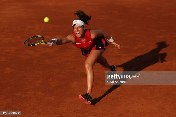 Johanna Konta of Great Britain stretches to play a forehand in her round three match against Garbine Muguruza of Spain during day five of the...