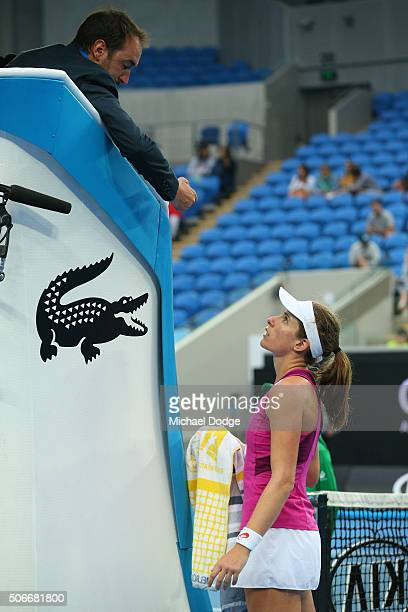 Johanna Konta of Great Britain talks to the chair umpire in her fourth round match against Ekaterina Makarova of Russia during day eight of the 2016...