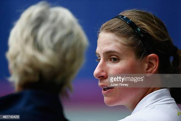 Johanna Konta of Great Britain talks with Captain Judy Murray in her match against Kathinka Von Deichmann of Liechtenstein during day one of the Fed...