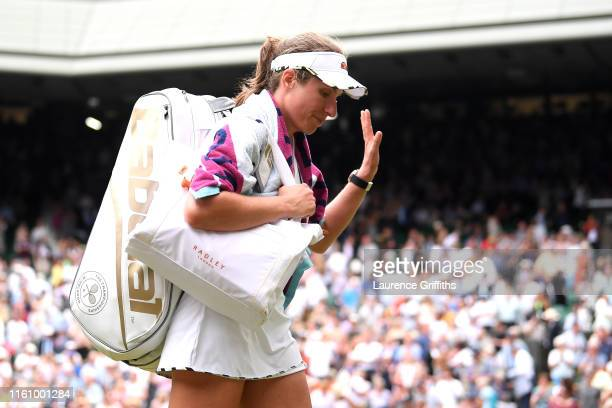 Johanna Konta of Great Britain walks off the court following defeat in her Ladies' Singles Quarter Final match against Barbora Strycova of Czech...