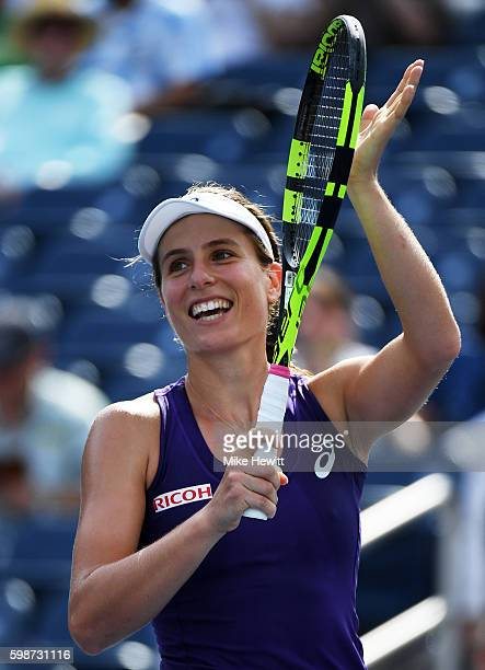 Johanna Konta of the United Kingdom celebrates her victory over Belinda Bencic of Switzerland during her third round Women's Singles match on Day...