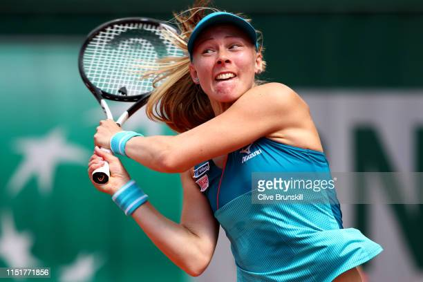 Johanna Larsson of Sweden plays a backhand during her ladies singles first round match against Magdalena Rybarikova of Slovakia during Day one of the...