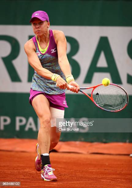 Johanna Larsson of Sweden plays a backhand during the ladies singles first round match against Bethanie MattekSands of The United Sands during day...