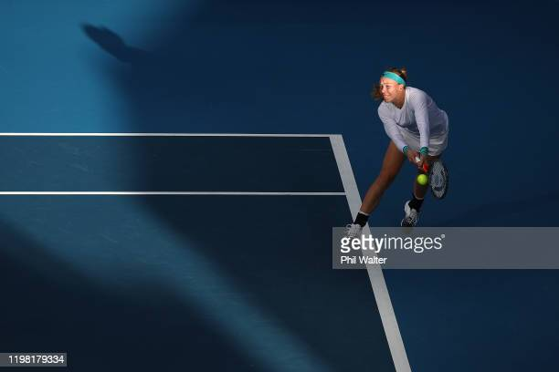 Johanna Larsson of Sweden plays a backhand with Caroline Dolehide of the USA during their doubles match against Caroline Wozniacki of Denmark and...