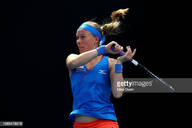 Johanna Larsson of Sweden plays a forehand in her first round doubles match with Kirsten Flipkens of Belgium against Timea Bacsinszky of Switzerland...